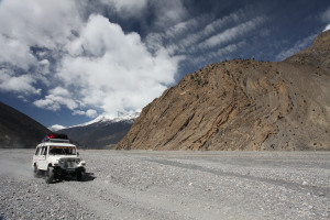 Jeeps crossing ancient river beds of Mustang's Kali Gandahki gorge